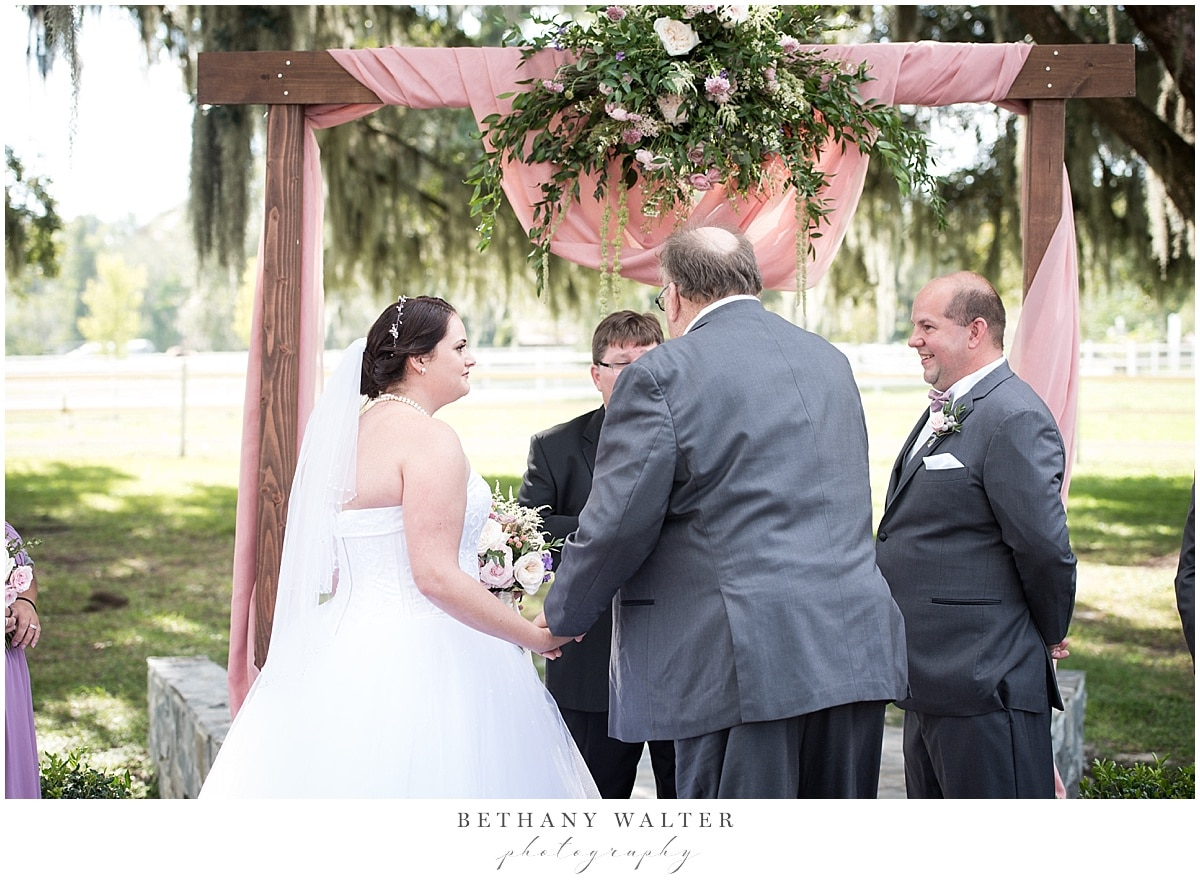 Father of the Bride walking the bride down the aisle at Plantation Oaks