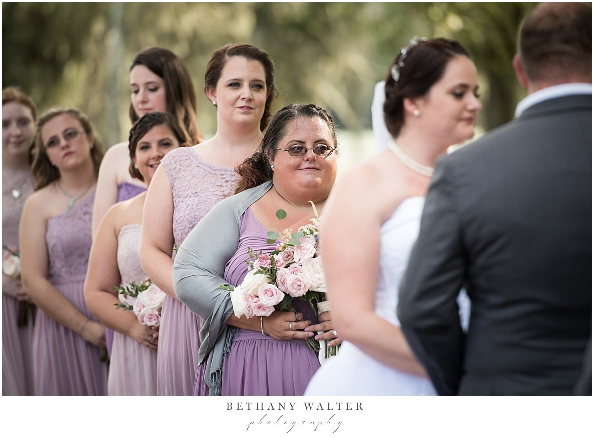 Maid of honor crying during the ceremony at Plantation Oaks