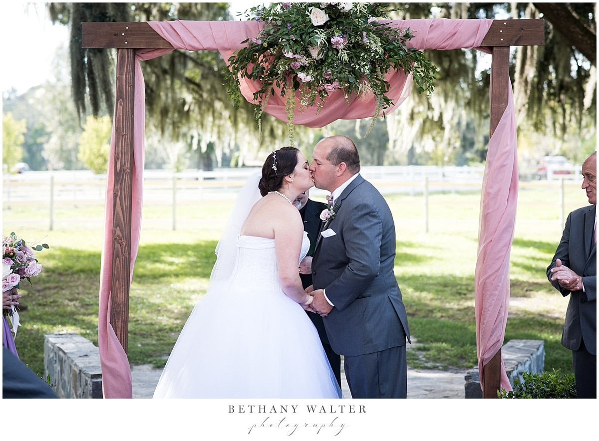 Bride and Groom pronounced husband and wife at Plantation Oaks