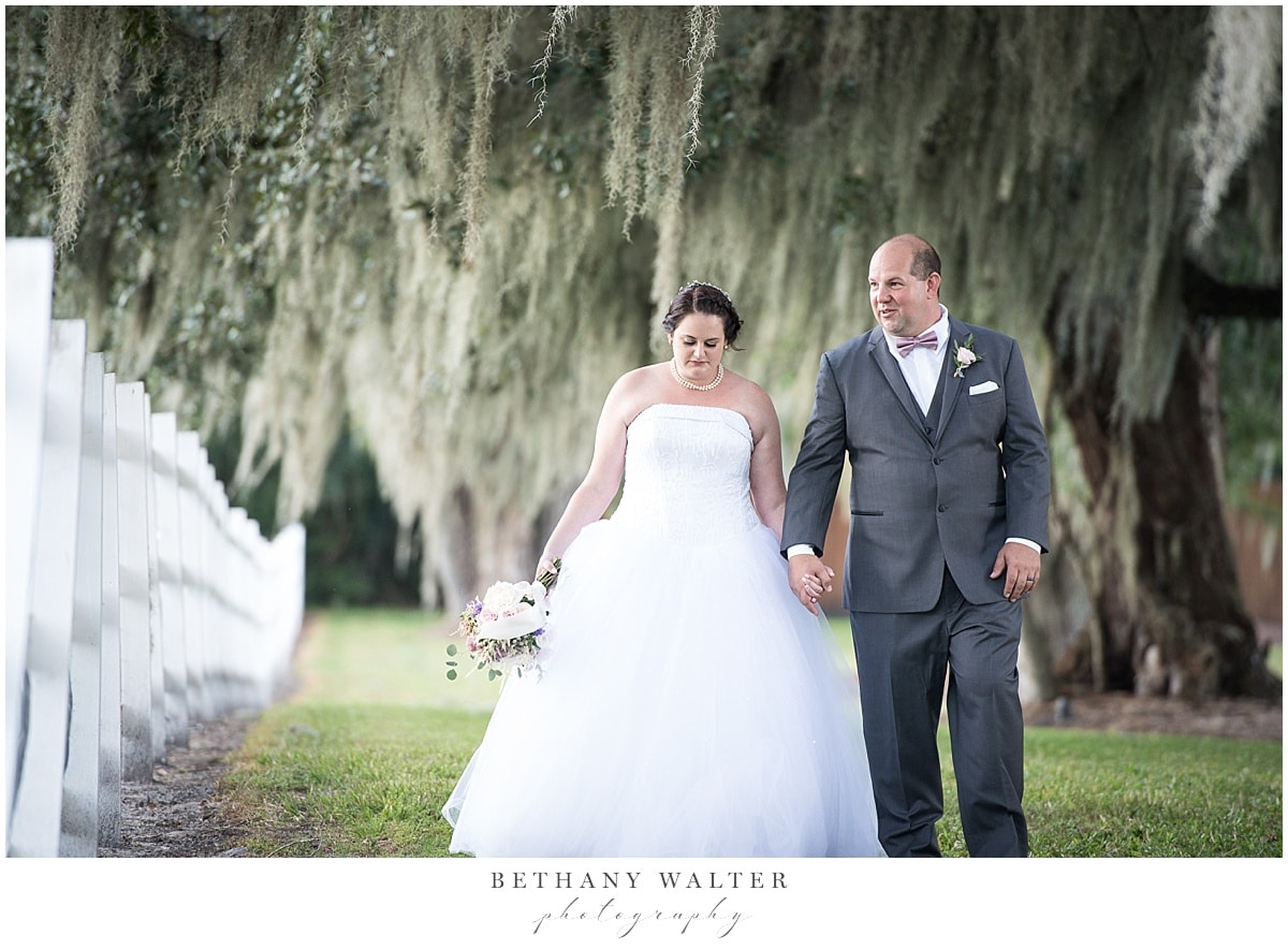 Bride and Groom under the trees at Plantation Oaks Wedding Venue