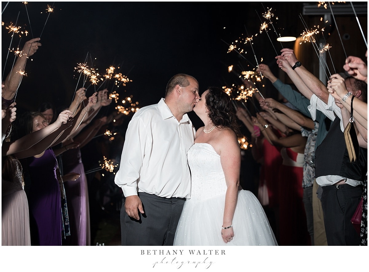 Bride and groom after their Plantation Oaks wedding reception during their sparkler exit