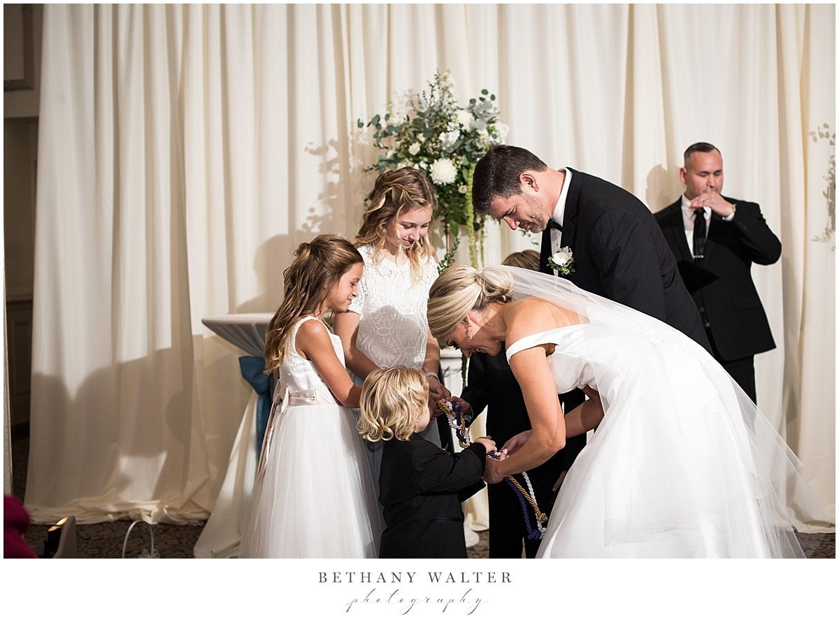 Bride and Groom Tying Three Strands of Cords with Their Kids