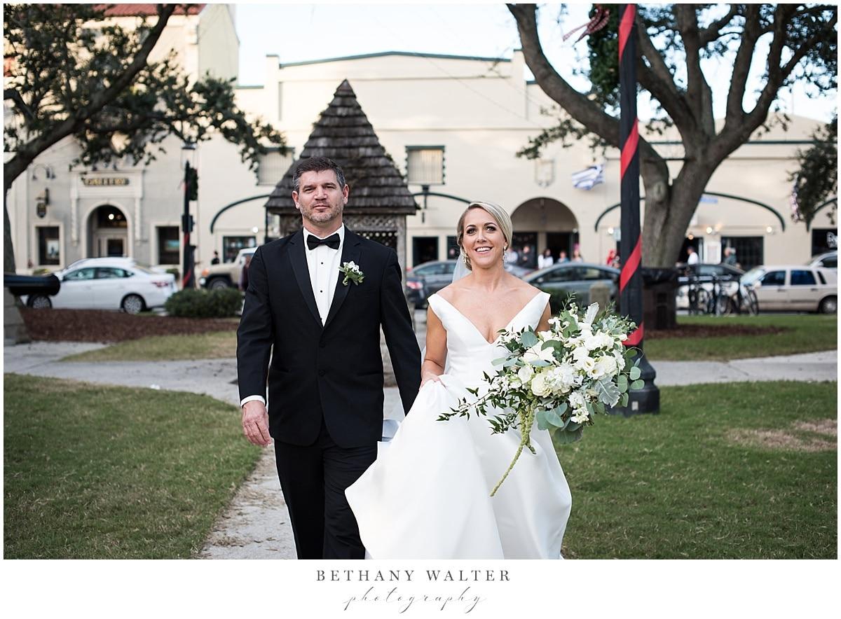 Bride and Groom Walking Thru St Augustine
